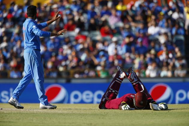West Indies captain Jason Holder lays on the pitch after getting home safely following a run out attempt alongside India's Ravindra Jadeja during their Cricket World Cup match in Perth