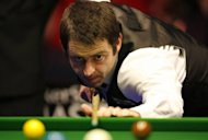 England's Ronnie O'Sullivan plays a shot during the final of the Masters snooker match in 2010. The world champion has settled his differences with the governing body of the sport and is set to return to the main tour