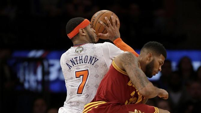 New York Knicks' Carmelo Anthony, left, collides with Cleveland Cavaliers' Alonzo Gee while taking a shot during the second half of the NBA basketball game at Madison Square Garden, Sunday, March 23, 2014, in New York. The Cavaliers defeated the Knicks 106 to 100