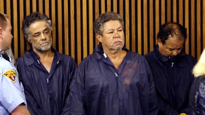 Onil Castro, left, Pedro Castro, center, and Ariel Castro, right, wait for their arraignment at Cleveland Municipal Court in Cleveland, Ohio, Thursday, May 9, 2013. Ariel Castro was charged with four counts of kidnapping and three counts of rape.   Pedro and Onil Castro, were held but faced no immediate charges. (AP Photo/David Duprey)