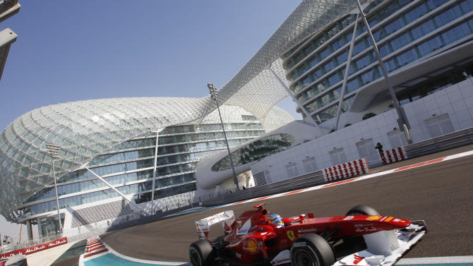 Ferrari driver Fernando Alonso of Spain steers his car during the third free practice at the Yas Marina racetrack , in Abu Dhabi, United Arab Emirates, Saturday, Nov.12, 2011. The Emirates Formula One Grand Prix will take place on Sunday. (AP Photo/Luca Bruno)