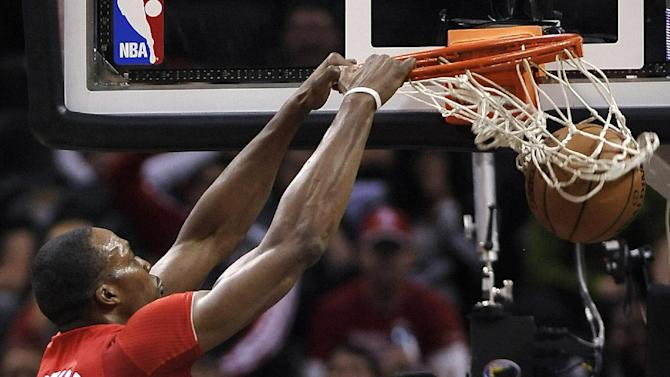 Houston Rockets forward Dwight Howard dunks during the first half of an NBA basketball game against the San Antonio Spurs on Wednesday, Dec. 25, 2013, in San Antonio
