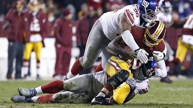 Washington Redskins quarterback Robert Griffin III (10) is sacked by New York Giants defensive tackle Johnathan Hankins (96) (Reuters)