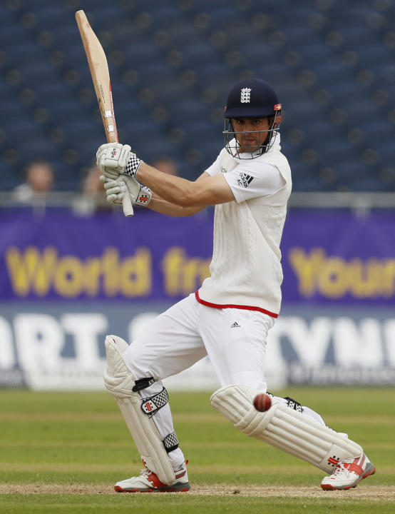 England's Alastair Cook hits a four