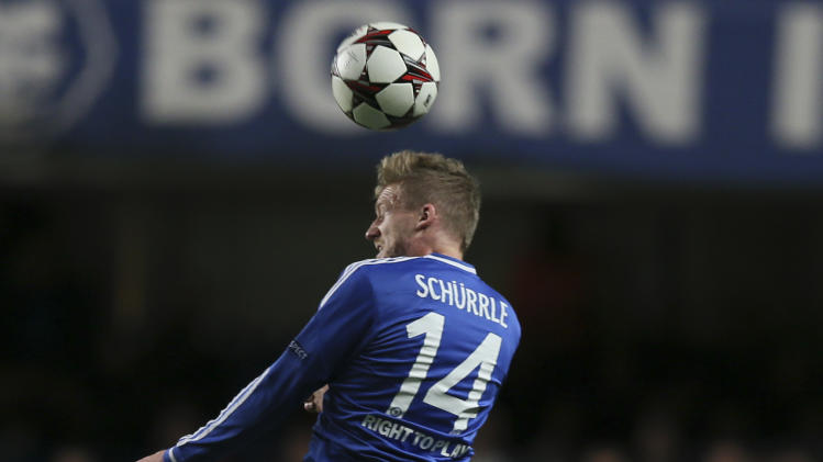Schalke's Atsuto Uchida, right, vies for the ball with Chelsea's Andre Schuerrle during the Champions League group E soccer match between Chelsea and FC Schalke 04 at Stamford Bridge stadium in London, Wednesday, Nov. 6, 2013