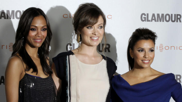 "Zoe Saldana, left, Olivia Wilde, center, and Eva Longoria pose together at a screening for ""Glamour Reel Moments"" in Los Angeles, Monday, Oct. 24, 2011. ""Glamour Reel Moments"" is a short film series that turns personal stores submitted by Glamour readers and turns them into short films. (AP Photo/Matt Sayles)"