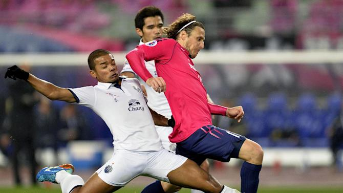Cerezo Osaka's Diego Forlan of Uruguay, right, is challenged for the ball by Buriram United's Prathum Chutong during their group stage soccer match at the Asian Champions League in Osaka, western Japan, Tuesday, March 18, 2014. Cerezo Osaka won the match, 4-0