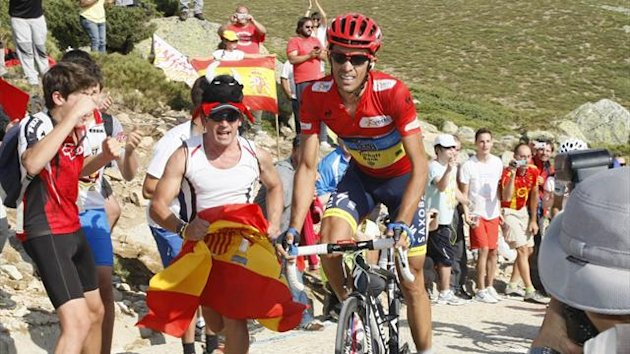 "Team Saxo Bank rider and race leader Alberto Contador of Spain cycles during the 20th stage of the Tour of Spain ""La Vuelta"" cycling race between La Faisanera Golf and Bola del Mundo (Reuters)"