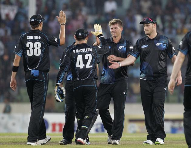 New Zealand's fielders celebrate after they dismissed Bangladesh's Abdur Razzak during their first ODI cricket match in Dhaka