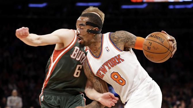 New York Knicks' J.R. Smith drives to the basket against Milwaukee Bucks' Nate Wolters during the first quarter of an NBA basketball game at New York's Madison Square Garden, Saturday, March 15, 2014