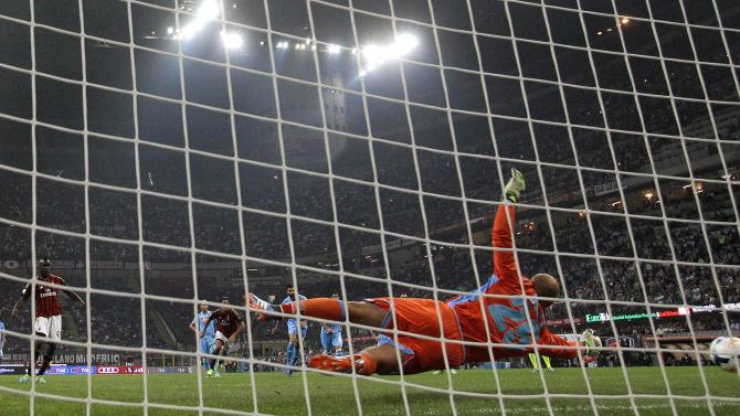 AC Milan's Balotelli shoot and fails to score penalty against Napoli goalkeeper Pepe Reina during their Italian Serie A soccer match at the San Siro stadium in Milan