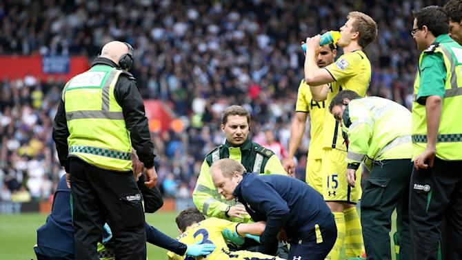 Football: Tottenham's Ben Davies recieves medical attention after sustaining an injury before being substituted