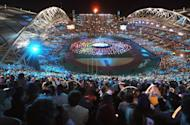 "This file photo shows people waving lights during the closing ceremony of the Sydney Olympic Games, in 2000. The Sydney Games are widely considered one of the ""best ever"", as they were described by the then Olympic chief Juan Antonio Samaranch, and Australian media admitted Britain's 2012 event came close"