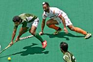 India's Sardar Singh (R) during an International Super Series hockey match in Perth on November 25, 2012. Singh was picked up by the Delhi Wave Riders franchise for $78,000 per tournament over the next three years