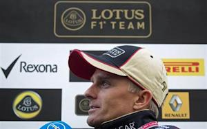 Lotus Formula One driver Heikki Kovalainen of Finland gives an interview after arriving at the Circuit of The Americas in Austin, Texas on November 14, 2013. REUTERS/Adrees Latif