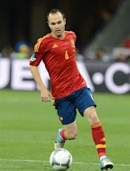 Spanish midfielder Andres Iniesta runs with the ball during the Euro 2012 football championships final match Spain vs Italy on July 1, 2012 at the Olympic Stadium in Kiev. AFP PHOTO / PATRICK HERTZOG