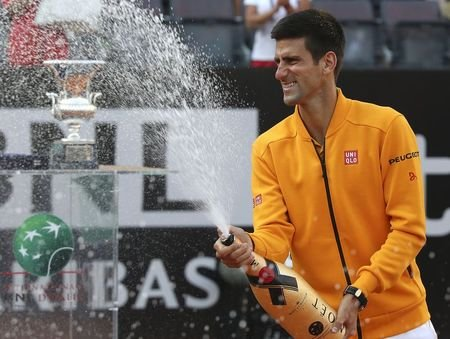 Novak Djokovic sprays champagne after winning the final