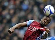 Former England Under-21 midfielder Nigel Reo-Coker, pictured in January 2011, has completed his move to Bolton Wanderers, the English Premier League club announced on Wednesday