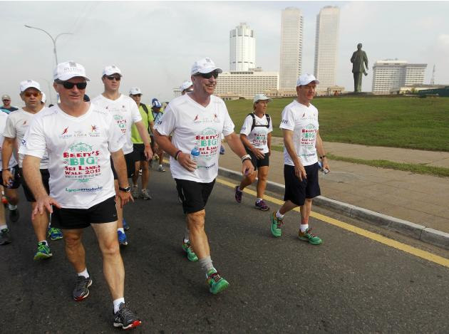 Former England cricket captain Botham and former Australian captain Waugh take part in a charity walk in Colombo