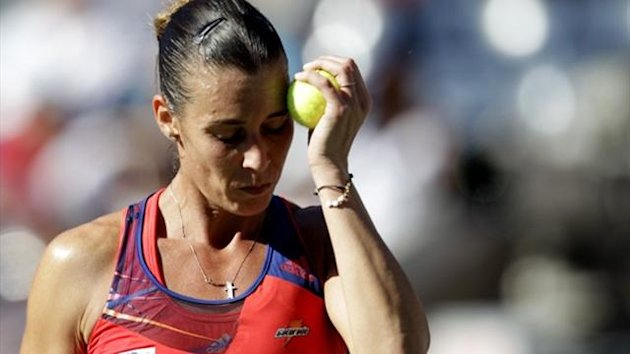 Flavia Pennetta of Italy reacts to a missed point against Victoria Azarenka of Belarus at the US Open (Reuters)
