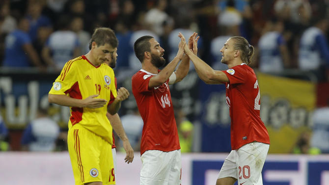 Turkey's Arda Turan, left, celebrates with Caner Erkin, right, at the end of a World Cup Group D qualifying soccer match between Romania and Turkey at the National Arena stadium in Bucharest, Romania, Tuesday, Sept. 10, 2013. Turkey beat Romania 2-0