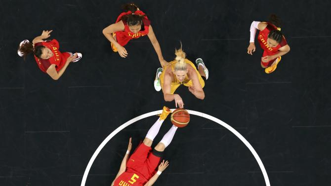 Australia's Jackson shoots over China's Song in the women's quarterfinal basketball match at the Basketball Arena in London