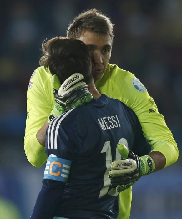Argentina's Messi  is greeted by Uruguay's goalie Muslera at the end of their first round Copa America 2015 soccer match at Estadio La Portada...