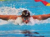 US swimmer Ryan Lochte claimed two gold medals on day one of the FINA short course championships