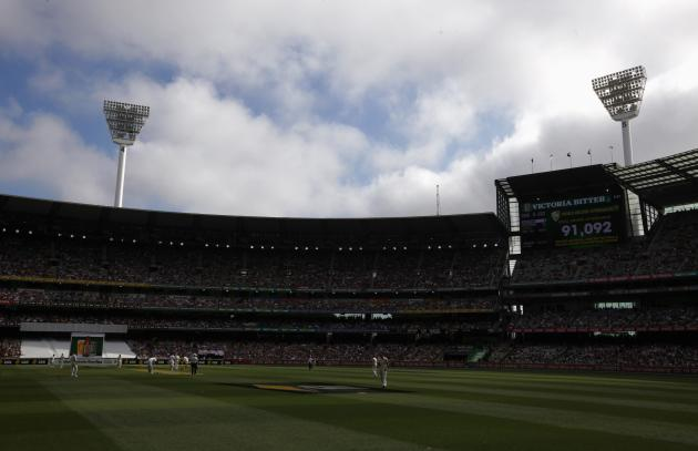 The scoreboard displays a sign declaring that a world record crowd attended the first day of the fourth Ashes cricket test between Australia and England at the Melbourne cricket ground