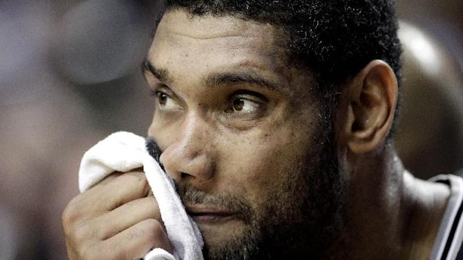 San Antonio Spurs forward Tim Duncan watches from the bench during the second half of an NBA basketball game against the Portland Trail Blazers in Portland, Ore., Saturday, Nov. 2, 2013. Portland defeated San Antonio 115-105