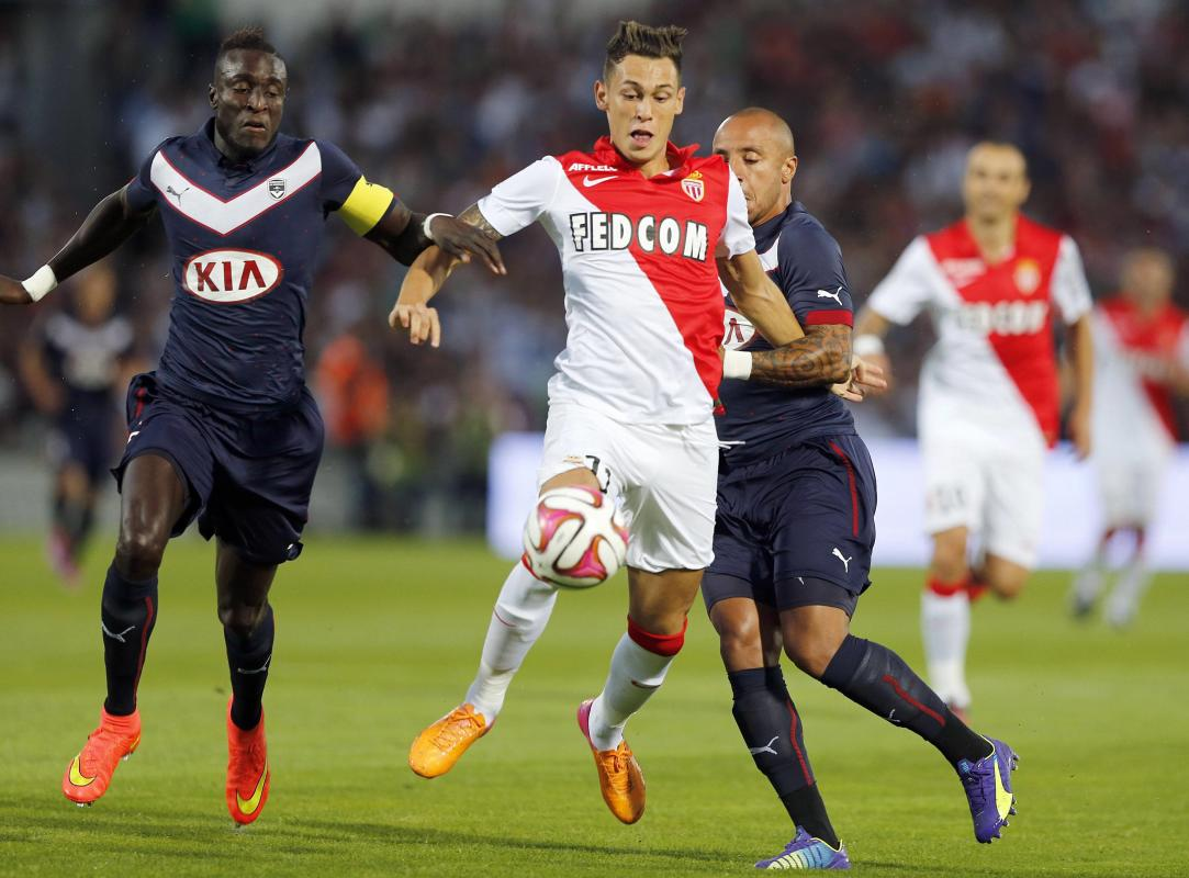 Ludovic Sane and Julien Faubert of Girondins Bordeaux fight for the ball with Lucas Ariel Ocampos of Monaco during their French Ligue 1 soccer match...