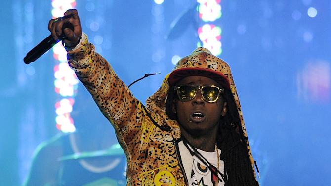 """FILE - In this March 1, 2012 file photo, Lil Wayne performs at the Caesars Entertainment """"Escape To Total Rewards"""" concert, in Los Angeles.  The multiplatinum rapper was hospitalized on Friday night, March 15, 2013, and reps confirmed he was """"recovering."""" A person close to the superstar rapper's camp who asked for anonymity because of the sensitivity of the matter confirmed to The Associated Press that Lil Wayne had a seizure. (AP Photo/Chris Pizzello, File)"""