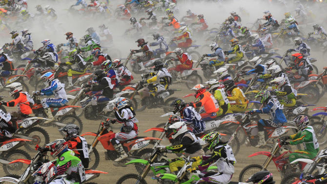 "Bikers start on sandy beach as they take part in the ""Enduropale"" motorcycle endurance race on the beach of Le Touquet"
