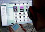 A man browses the iTunes music store. Canada's Supreme Court ruled Thursday that no royalties need to be paid to recording artists or song publishers when videogames or movie soundtracks are downloaded on the Internet