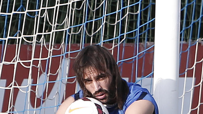 Greece's Giorgos Samaras sits on a ball during a training session in Athens, Monday, Oct. 14, 2013, ahead of their 2014 World Cup Group G qualifying match against Liechtenstein on Tuesday