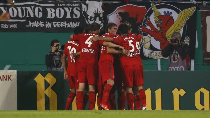 Bayer Leverkusen's players celebrate a goal against Arminia Bielefeld during the second round of their German soccer cup match in Bielefeld