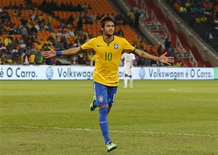 Brazil's Neymar celebrates his goal against South Africa during their international friendly soccer match at the First National Bank (FNB) Stadium, also known as Soccer City, in Johannesburg
