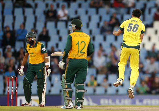Australia's Mitchell Starc celebrates after bowling out South Africa's Hashim Amla during the final of the T20 cricket test match in Centurion