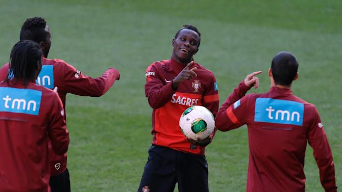 Portugal's Bruma, center, jokes with his teammates during a training session Sunday, Nov. 17 2013, at the Luz stadium in Lisbon. Portugal will play Sweden Tuesday in a World Cup qualifying playoff second-leg soccer match