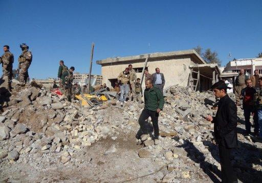 Iraqis inspect the site of an explosion on January 16, 2013, in Kirkuk, north of Baghdad. Attacks in Iraq killed three people and wounded six others on Monday, as the country grapples with more than a month of anti-government rallies and a political crisis, officials said
