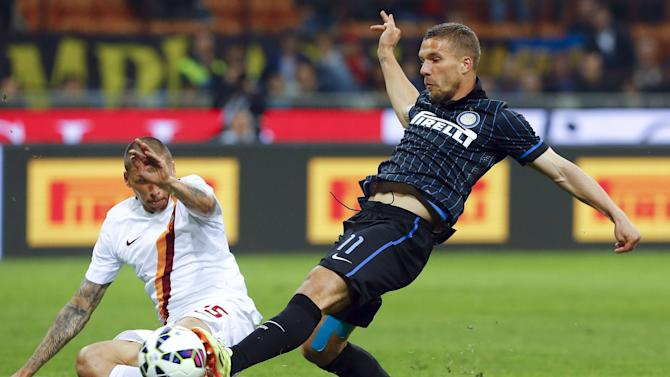 AS Roma's Holebas challenges Inter Milan's Podolski during their Serie A soccer match at the San Siro stadium in Milan