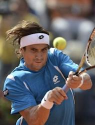 Spain's David Ferrer retuns a ball to compatriot Rafael Nadal during their semi-finals match of the ATP Rome tournament. Nadal won 7-6 (8/6), 6-0