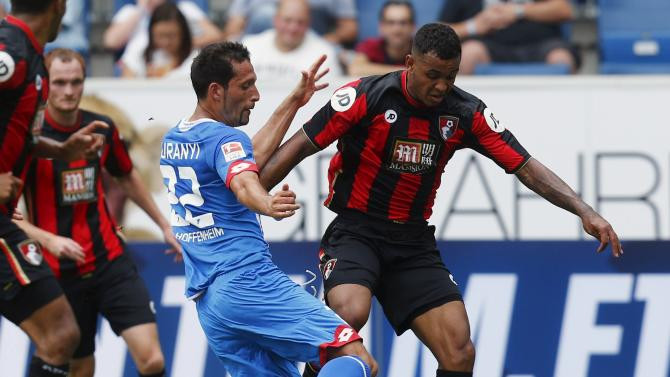 TSG Hoffenheim's Kuranyi challenges AFC Bournemouth's Joshua King during a pre season soccer friendly match in Hoffenheim