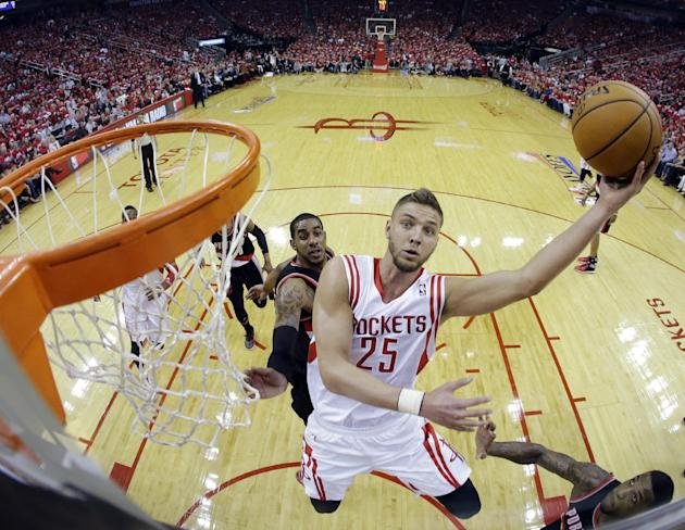 Houston Rockets' Chandler Parsons (25) shoots during the first half in Game 1 of an opening-round NBA basketball playoff series against the Portland Trail Blazers, Sunday, April 20, 2014, in Houst