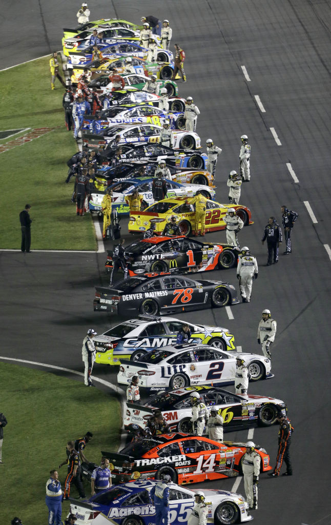 Cars line up along the front stretch before the NASCAR Sprint All-Star ...