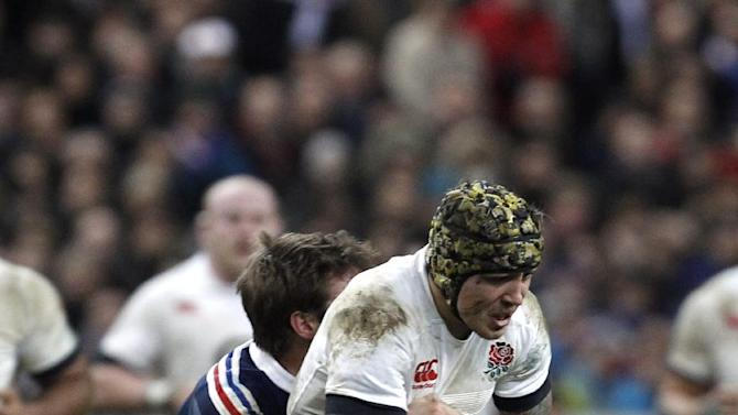 England's Jack Nowell is tackled by France's Maxime Medard, during their Six Nations rugby union international match, at the Stade de France, in Saint Denis, outside Paris, Saturday, Feb 1, 2014. France defeated England 26-24. (AP Photo/Thibault Camus)