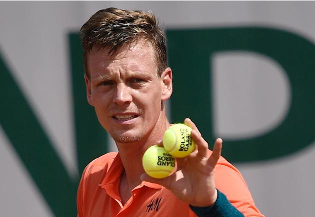 Fourth seed Tomas Berdych ousted Japanese qualifier Yoshihito Nishioka in three sets in the first round of the French Open on May 25, 2015