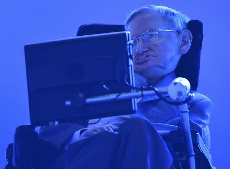 File photograph of British physicist Stephen Hawking in the Olympic Stadium during the opening ceremony of the London 2012 Paralympic Games
