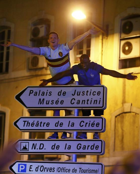 France v Germany - Euro 2016 - Semi Final - Fans celebrate atop a street sign in Marseille
