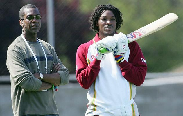 HOBART, TAS - NOVEMBER 16: (L-R) Former West Indies bowling great Michael Holding talks with Chris Gayle of the West Indies during training at Bellerive Oval on November 16, 2005 in Hobart, Australia.